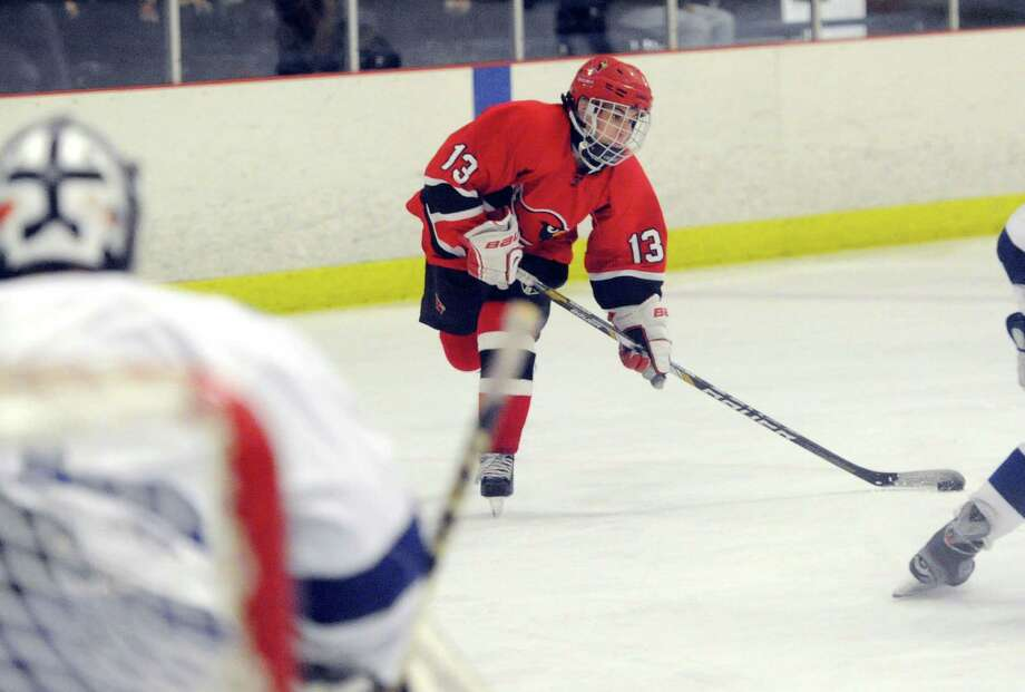 Kristian Cunningham (#13) of Greenwich prepares to shoot during the CIAC Division I boys ice hockey playoff game between Greenwich High School and Darien High School at Darien Rink in Darien, Conn., Wednesday, March 12, 2014. Photo: Bob Luckey / Greenwich Time