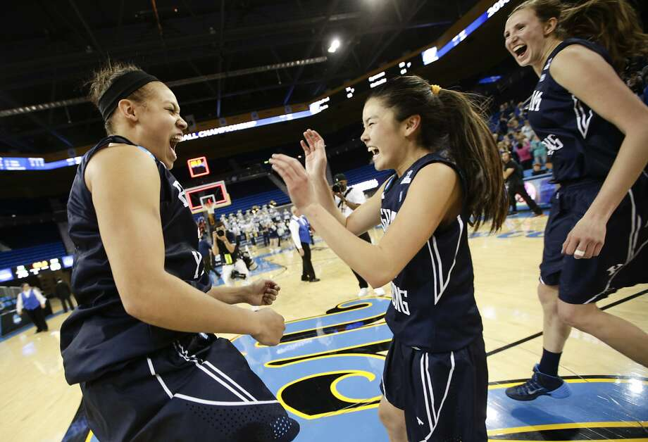 BYU's Morgan Bailey, from left, Kylie Maeda, and Jennifer Hamson celebrate after defeating Nebraska in a second-round game of the NCAA women's college basketball tournament on Monday, March 24, 2014, in Los Angeles. BYU won 80-76. (AP Photo/Jae C. Hong) Photo: Jae C. Hong, Associated Press