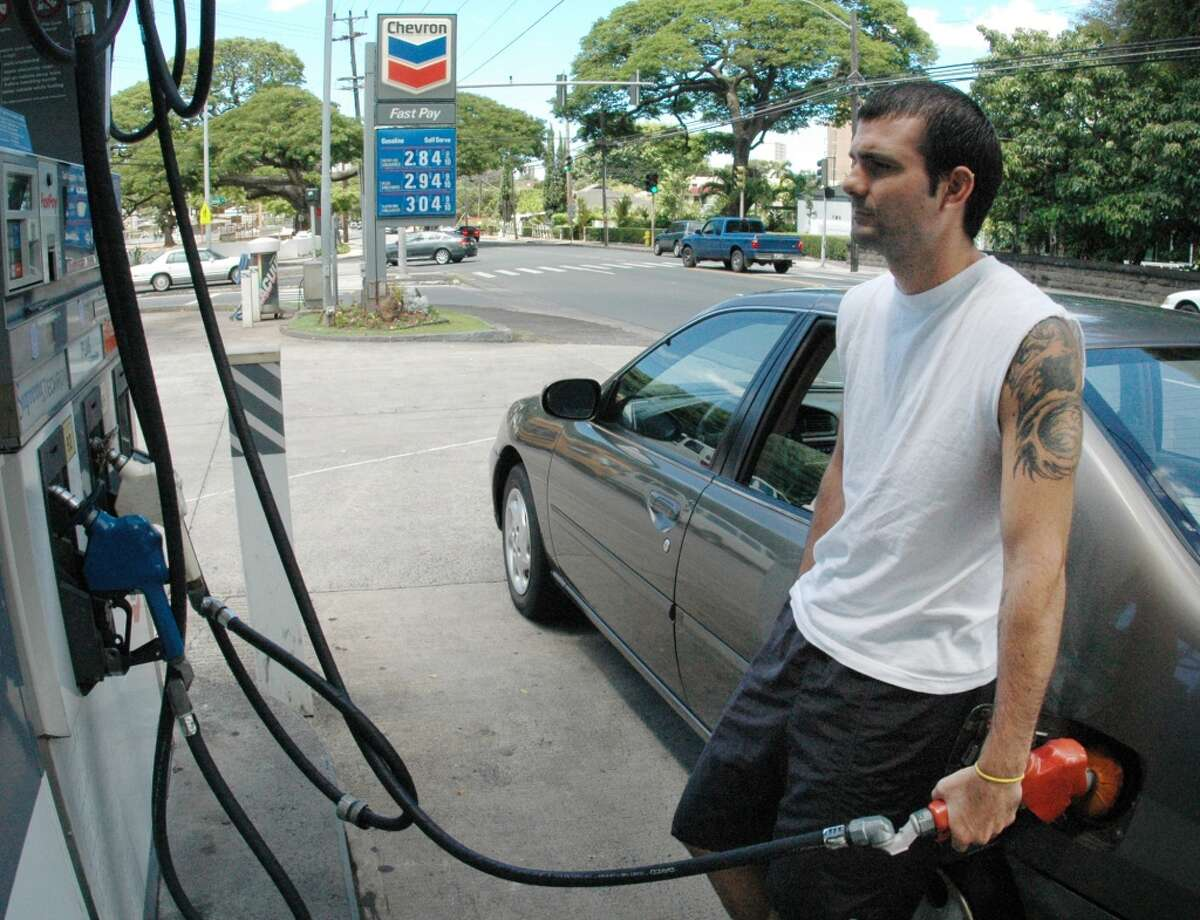 1. Hawaii -- $4.213 [Photo: Chris Cusmano fills his car's gas tank in Honolulu in August 2005. Gas prices in the state have soared since then.]