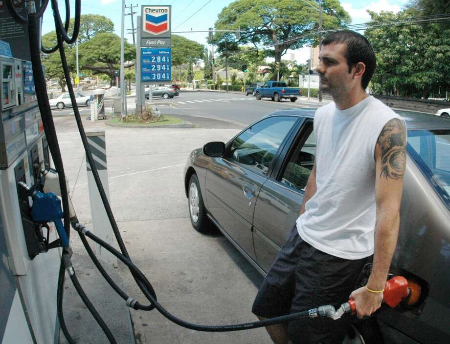 1. Hawaii -- $4.213  [Photo: Chris Cusmano  fills his car's gas tank in Honolulu in August 2005. Gas prices in the state have soared since then.] Photo: RONEN ZILBERMAN, AP