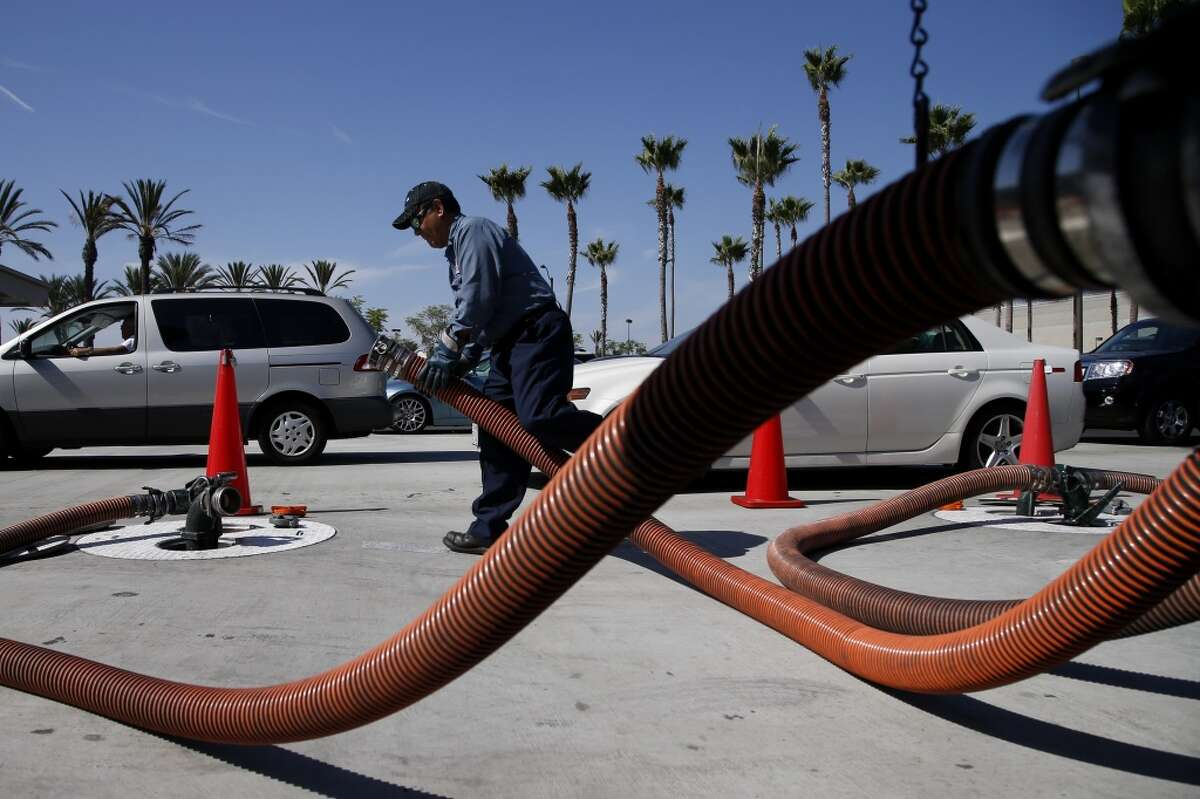 2. California -- $3.976 [Photo: Rudy Rocha delivers gasoline to a Costco station in Tustin, Calif. in October 2012.]