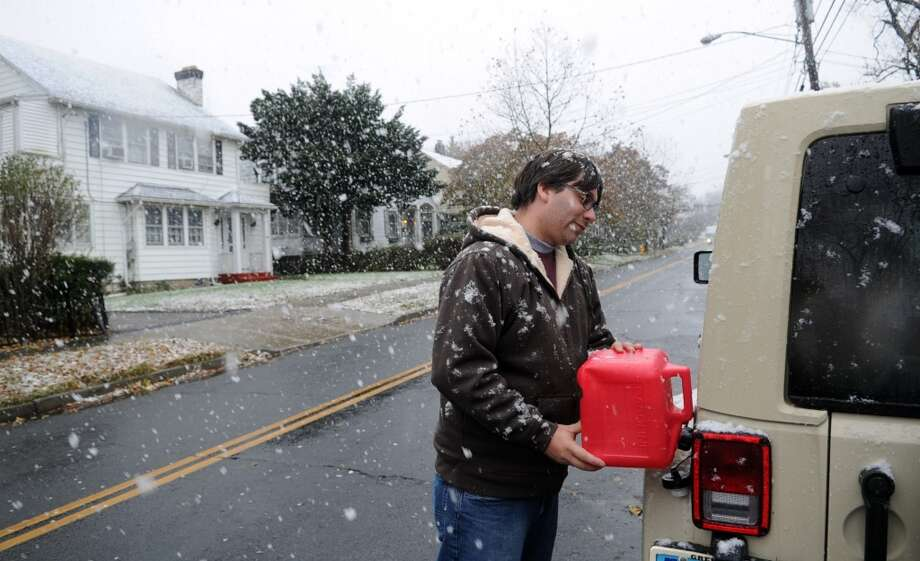 5. Connecticut -- $3.768  [Photo: Andrew Schnelwar fills his car with gasoline left over from the generator he used during Superstorm Sandy as snow begins to fall from a nor'easter in Stamford, Conn. in November 2012.] Photo: Lindsay Niegelberg