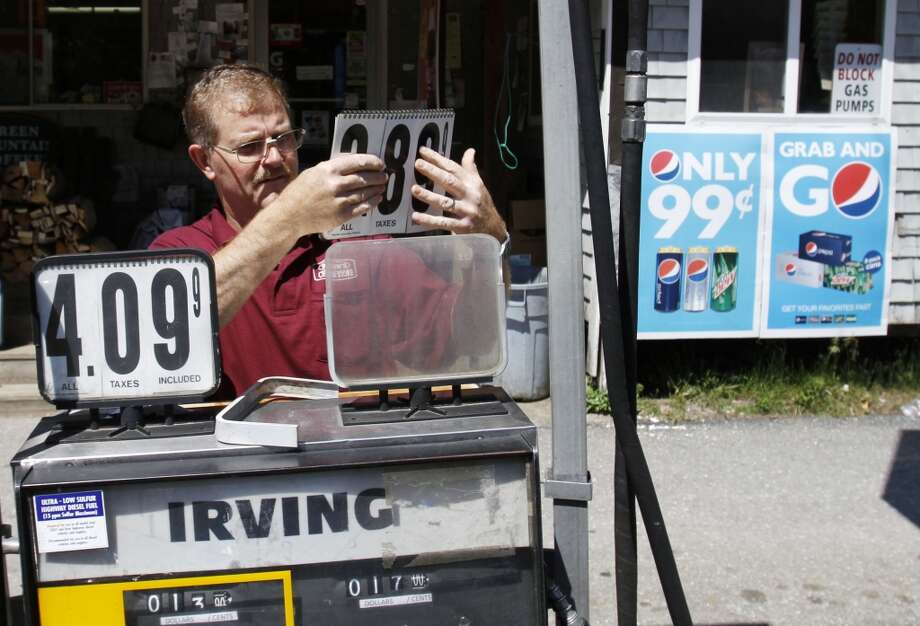 10. Maine -- $3.635  [Photo: Convenience story owner Floyd Bisson, lowers the price of regular gas at the pumps in front of his store in Phippsburg, Maine in June 2011.] Photo: Pat Wellenbach, Associated Press