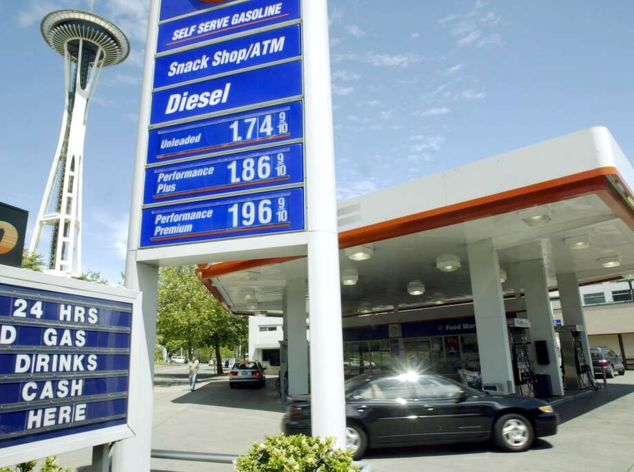 9. Washington -- $3.636  [Photo: A car passes through a gas station near the Space Needle Monday in June 2003 in Seattle.] Photo: TED S. WARREN, AP