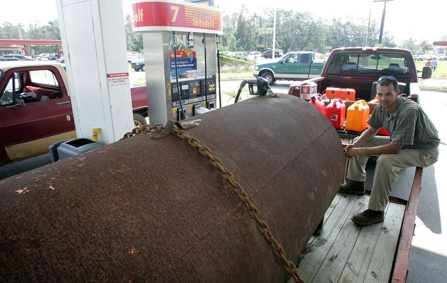 45. Alabama -- $3.302  [Photo: Joe Stevens, of Mobile fills his 1,500 gallon gasoline tank after waiting for approximately one hour in line at a Shell gas station along Interstate 10 in Mobile, Alabama August 30, 2005. Hurricane Katrina, which hit the Mississippi Gulf Coast on August 29, caused numerous deaths, severe property damage and power outages in that part of the region. REUTERS/Frank Polich Photo: FRANK POLICH, REUTERS