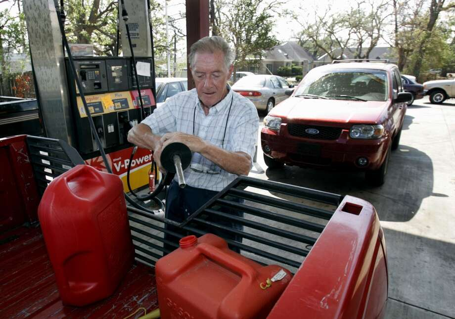 48. Mississippi -- $3.282  [Photo: Bill Butler, of Biloxi, fills gas cans for his generator in front of a long line of cars  at a gas station in Biloxi, Miss. in September 2005.] Photo: STEVE HELBER, AP