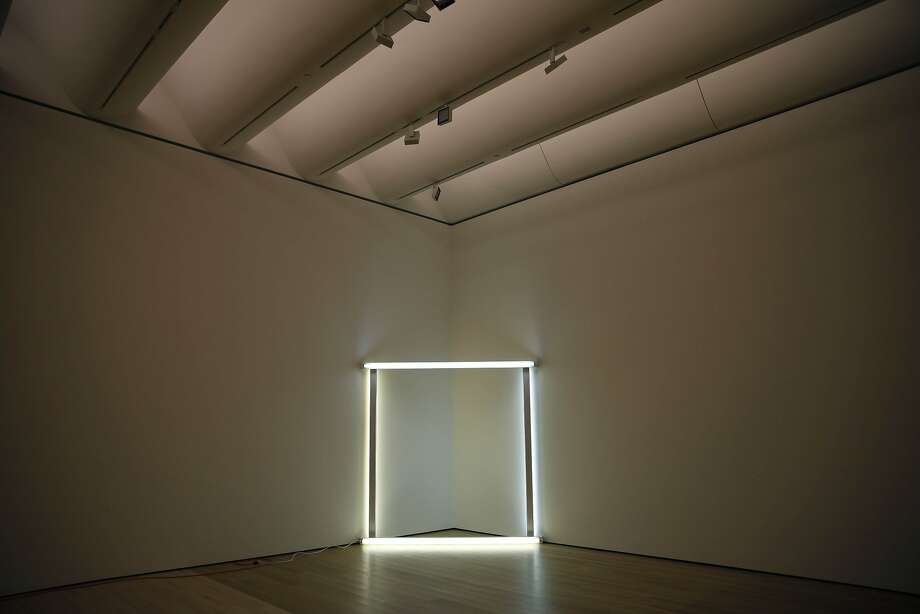 A fluorescent installation by artist Dan Flavin resides in a corner of the mock-up gallery at SFMOMA's Collections Center. Photo: Lea Suzuki, The Chronicle