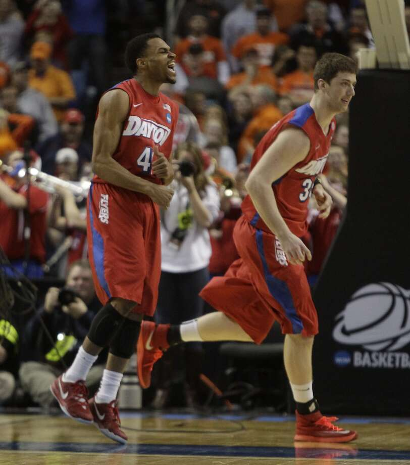 Dayton's Vee Sanford (left) and Matt Kavanaugh celebrate their victory over Syracuse on Saturday. Photo: Bill Wippert, Associated Press