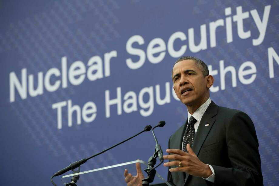 President Barack Obama speaks during their joint news conference with Dutch Prime Minister Mark Rutte at the conclusion of the Nuclear Security Summit in The Hague, Netherlands, Tuesday, March 25, 2014. (AP Photo/Pablo Martinez Monsivais) Photo: Pablo Martinez Monsivais, STF / AP