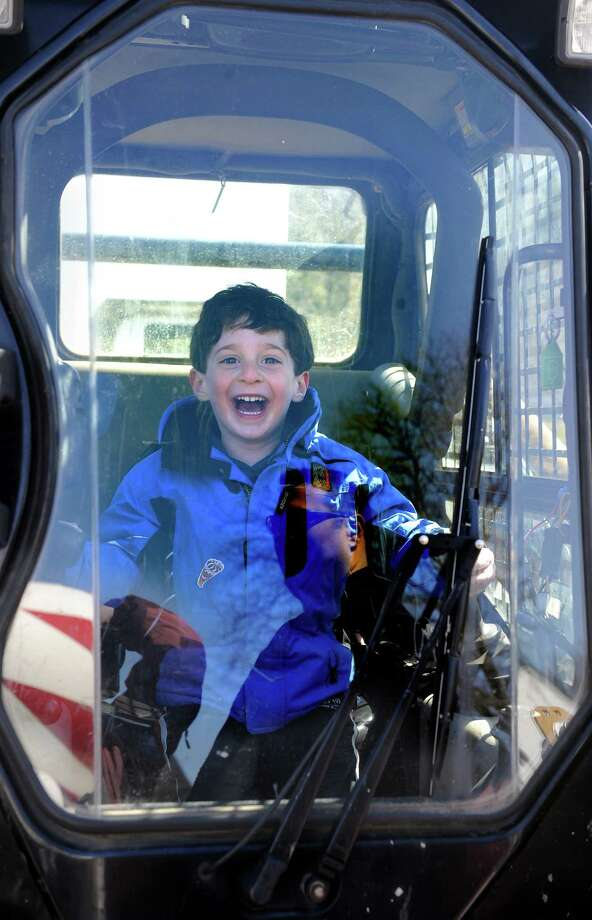 "At the Westport Weston Cooperative Nursery School's ""touch-a-truck"" day in 2011, Matthew Katzman, of Westport, then 5, got a thrill sitting in the cab of a shovel truck. This year's event is Saturday, March 29, from 9:30 a.m. to 1:30 p.m. at Coleytown Elementary School. Photo: Autumn Driscoll, Westport News File Photo / Connecticut Post"