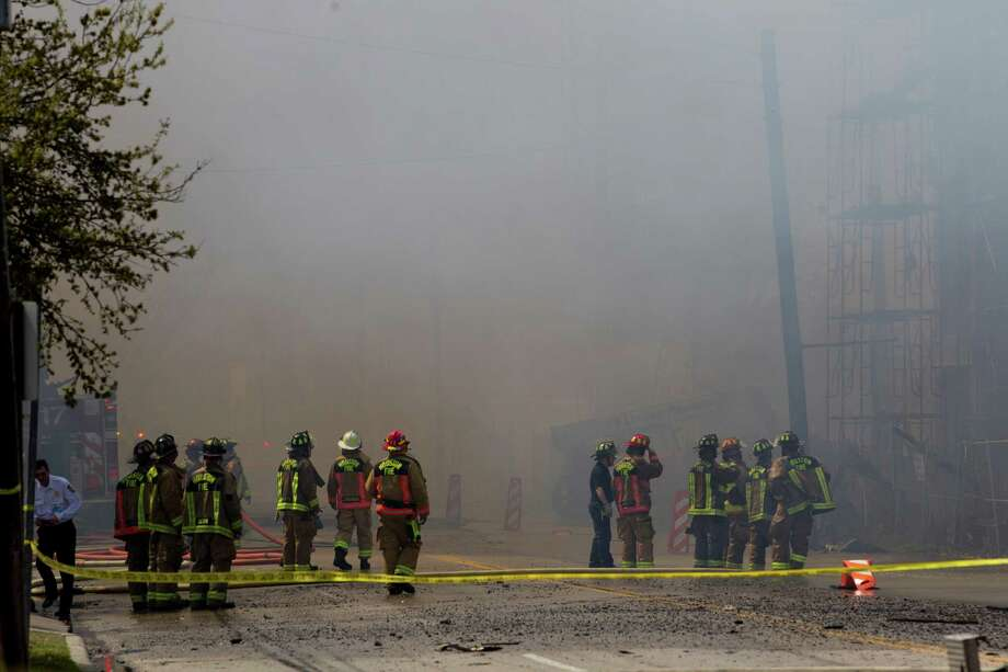 Firefighters battled a large 5-alarm blaze Tuesday afternoon at an apartment building under construction on West Dallas near Montrose Tuesday, March 25, 2014, in Houston. Flames engulfed the apartment complex as 200 firefighters in 80 units fought to gain an upper hand on the blaze. The five-story, 368-unit building was destroyed. No injuries were reported. Photo: Johnny Hanson, Houston Chronicle / © 2014  Houston Chronicle