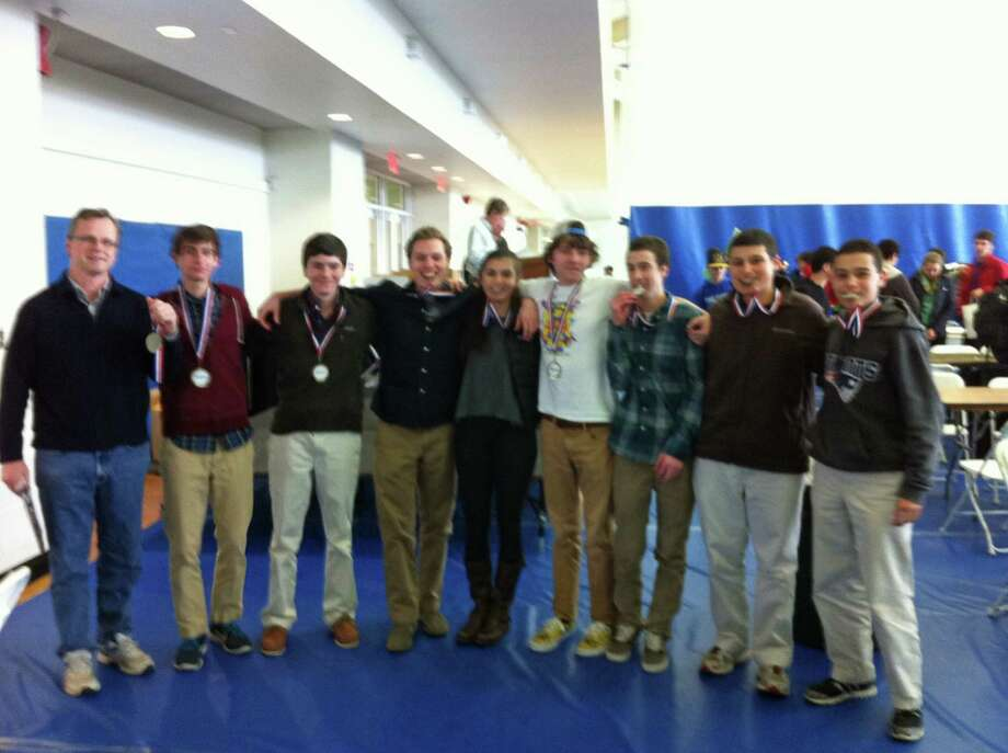 The New Canaan High School's junior varsity Tests of Engineering Aptitude, Mathematics and Science team placed first in the state results for the recent national competition. From left, Coach Jeff Hague, Robbie Fusek, Chris Reik, Miles Turpin, Mia Carroll, Captain Ethan Geller, Griffin Edmonds and Charlie Pitteway. Photo: Contributed Photo, Contributed / New Canaan News Contributed