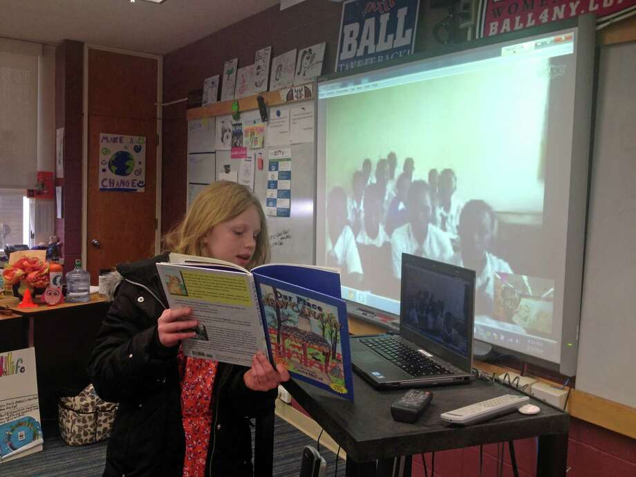 Fifth-grader Riley Gibbons, of New Canaan, participates in World Read Aloud Day at New Canaan Country School. Photo: Contributed Photo, Contributed / New Canaan News Contributed