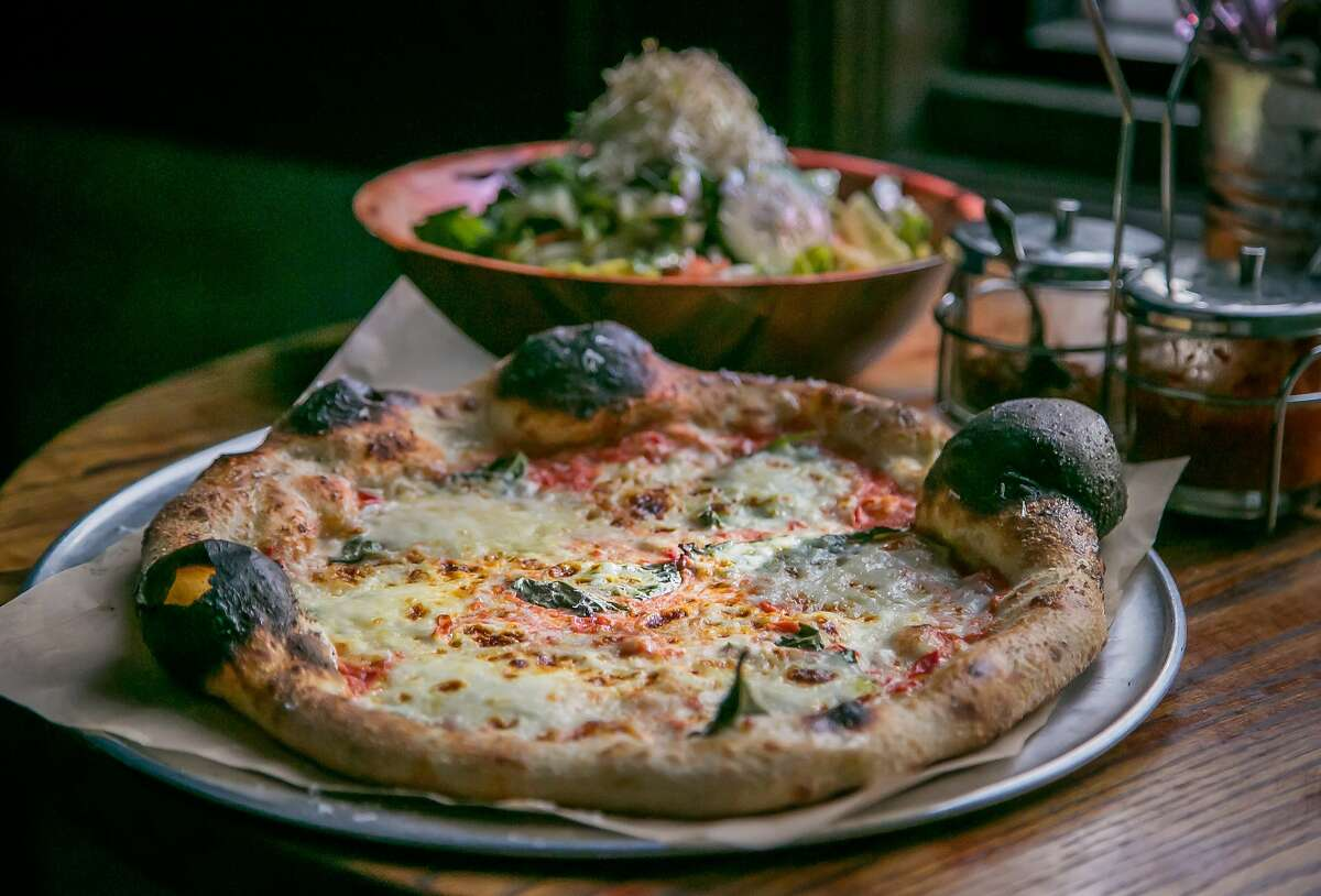 The Margherita pizza and the Intermezzo salad at Pizza Hacker in San Francisco, Calif., is seen on Thursday, March 20th, 2014.