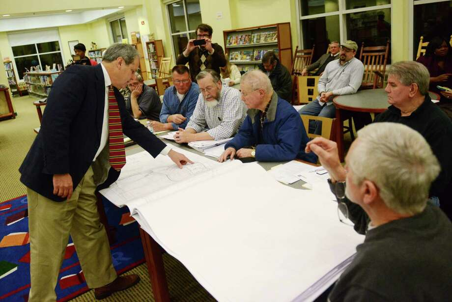 "Jay Brotman, of Svigals & Partners, shows Svigals & Partners' architectural plans for the new Sandy Hook Elementary School to the Newtown Public Building and Site Commission at Reed Intermediate School in Newtown, Conn. on Tuesday, March 25, 2014.  School and town leaders have endorsed a plan referred to as the ""Main Street'' theme that offers a unique design for the 80,000 square foot building using natural elements and the surrounding landscape to create a welcoming educational space. Photo: Tyler Sizemore / The News-Times"
