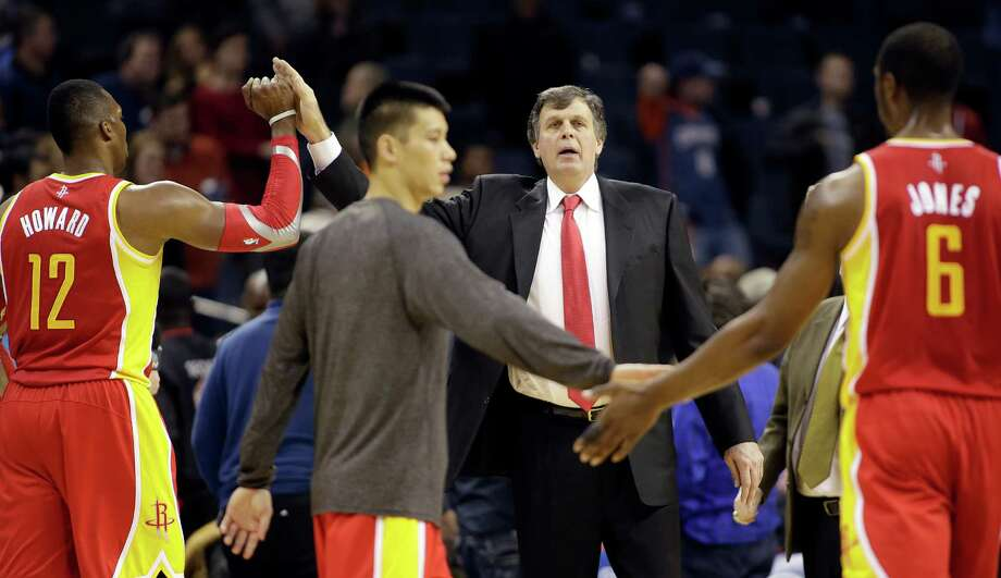 The Rockets - including from left, Dwight Howard, Jeremy Lin, coach Kevin McHale and Terrence Jones - were satisfied with Monday's effort in Charlotte. Photo: Bob Leverone, FRE / FR170480 AP