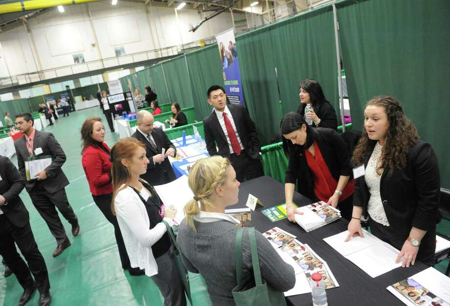Katie Marino, right, of Travelers speaks with job searchers during the Siena College spring Career, Internship and Graduate School Fair Tuesday, March 25, 2014, at the Marcelle Athletic Complex in Loudonville, N.Y. (Michael P. Farrell/Times Union) Photo: Michael P. Farrell / 00026238A