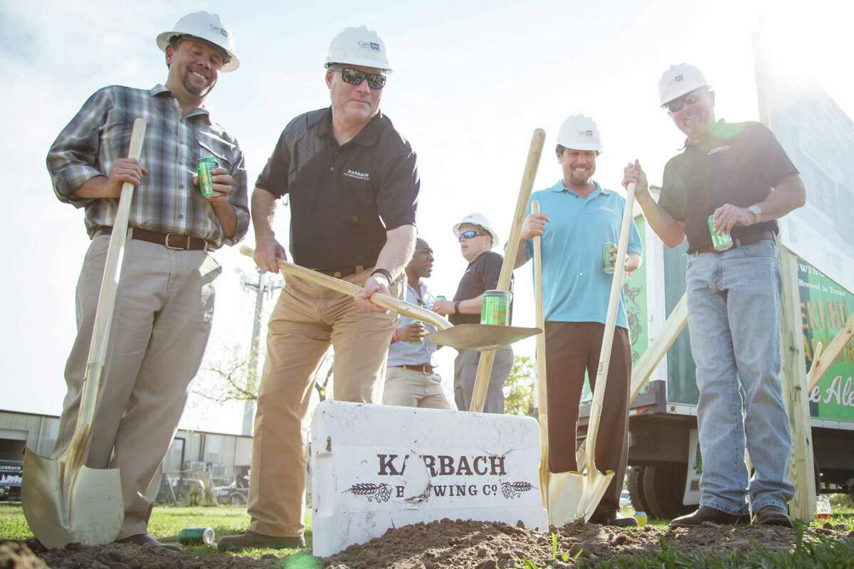 David Greenwood, left to right, Ken Goodman, Eric Warner and Chuck Robertson celebrate the groundbreaking ceremony for the expansion of the Karbach Brewing Co., Tuesday, March 25, 2014, in Houston. The $15 million expansion project on Karbach Street will be able to produce 60,000 barrels annually with room for future growth. In addition to more beer, Karbach also expects to add a projected 100 jobs to the Houston community. ( Michael Paulsen / Houston Chronicle )