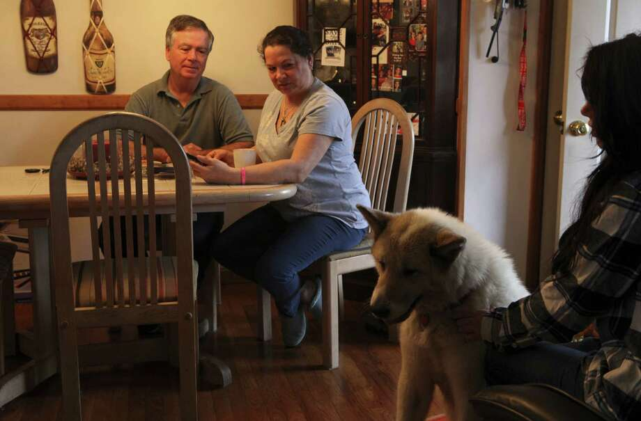 Michelle and Neil Kosilla look over photos of their daughter Amy, who died in a Chevrolet Cobalt accident in 2010, with her younger sister, Lisa and Amy's dog, Shakira, at their home in Fishkill, N.Y. Photo: Susan Stava / New York Times / NYTNS