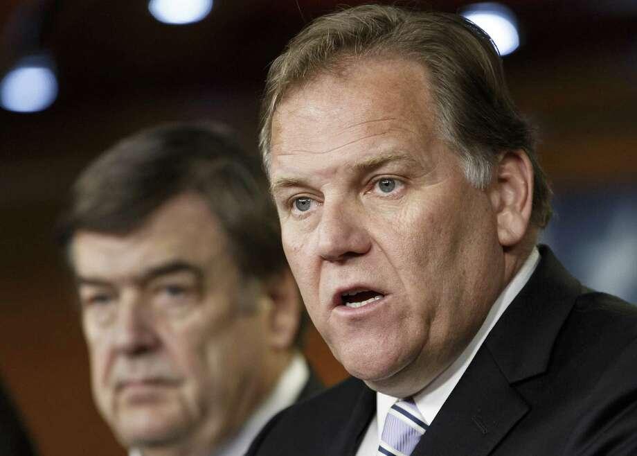 The proposal the White House is preparing is similar to legislation sponsored by House Intelligence Committee Chairman Rep. Mike Rogers, R-Mich. (right), and the committee's ranking member, Rep. C.A. Dutch Ruppersberger, D-Md. Photo: J. Scott Applewhite / Associated Press / AP