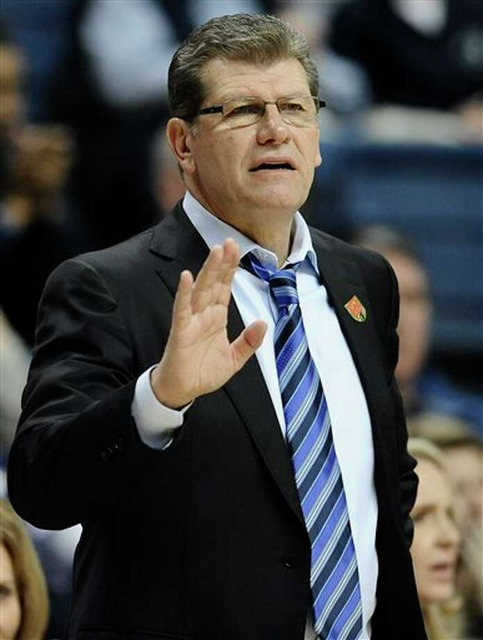 Connecticut head coach Geno  Auriemma gestures to his team during the second half of a second-round  game against Saint Joseph's in a NCAA women's college basketball  tournament, Tuesday, March 25, 2014, in Storrs, Conn.  Connecticut won  91-52. (AP Photo/Jessica Hill)