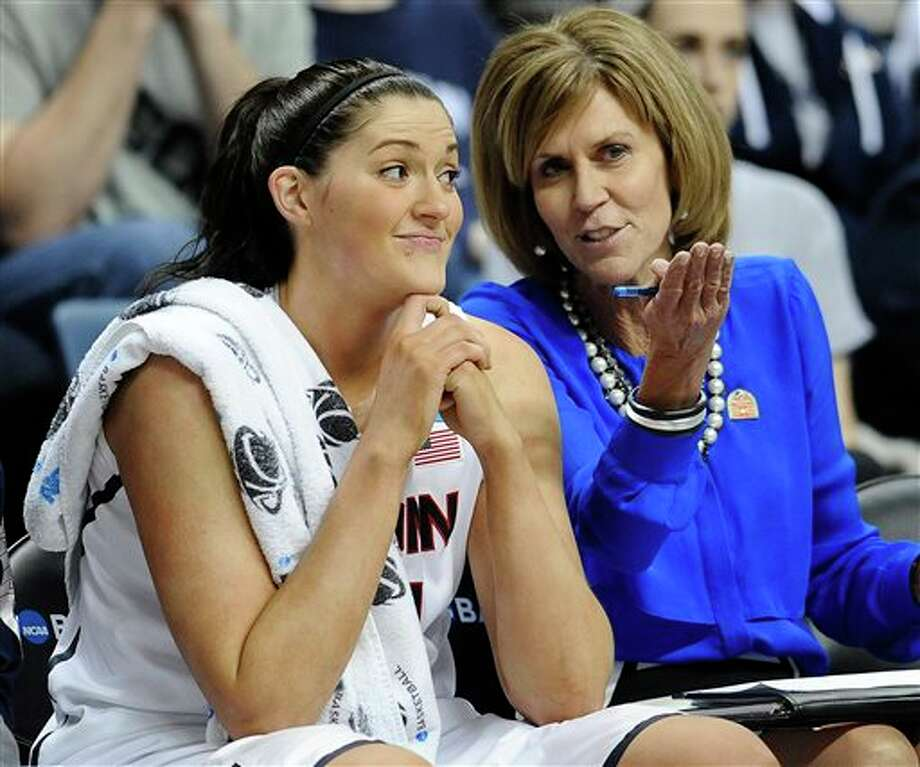 Connecticut's Stefanie  Dolson, listens to associate head coach Chris Dailey, right, during the  second half of a second-round game of the NCAA women's college  basketball tournament, Tuesday, March 25, 2014, in Storrs, Conn.   Connecticut won 91-52. (AP Photo/Jessica Hill)