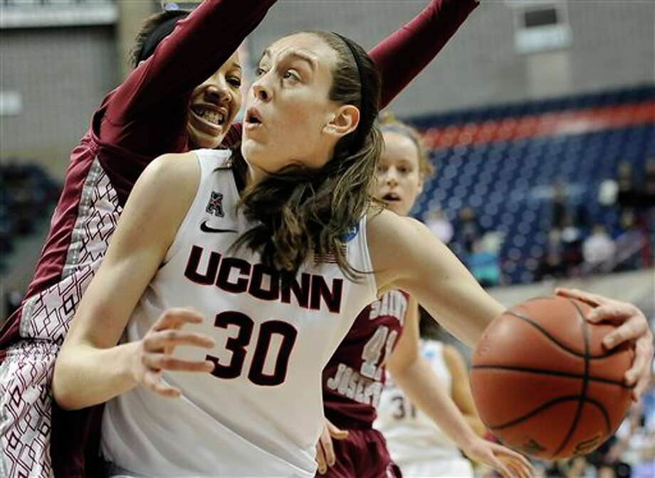 Connecticut's Breanna  Stewart, right, pushes past Saint Joseph's Ashley Robinson, left, during  the second half of a second-round game of the NCAA women's college  basketball tournament, Tuesday, March 25, 2014, in Storrs, Conn. (AP  Photo/Jessica Hill)
