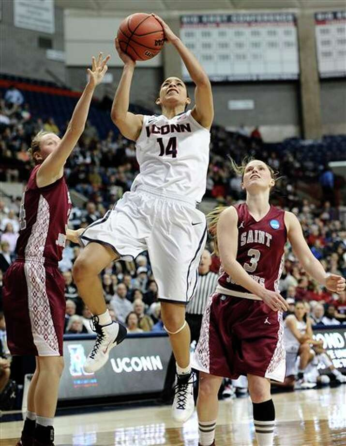 Connecticut's Bria Hartley,  center, shoots as Saint Joseph's Kelsey Berger, left, and Erin Shields,  right, defend during the second half of a second-round game of the NCAA  women's college basketball tournament, Tuesday, March 25, 2014, in  Storrs, Conn.  Connecticut won 91-52. (AP Photo/Jessica Hill)