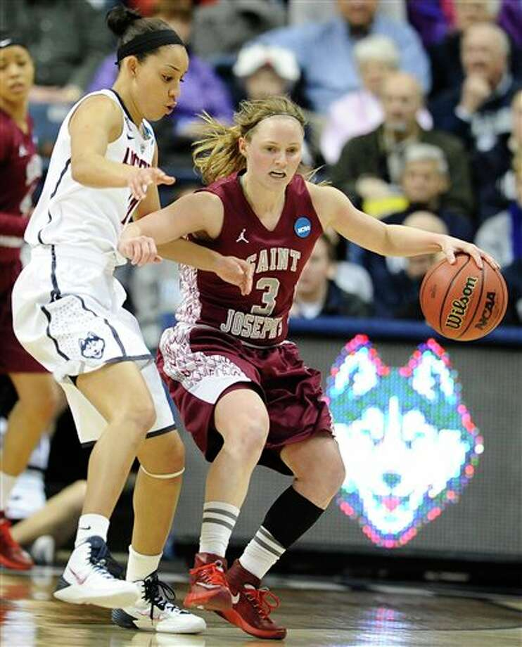 Saint Joseph's Erin Shields,  right, is pressured by Connecticut's Bria Hartley, left, during the  second half of a second-round game of the NCAA women's college  basketball tournament, Tuesday, March 25, 2014, in Storrs, Conn. (AP  Photo/Jessica Hill)