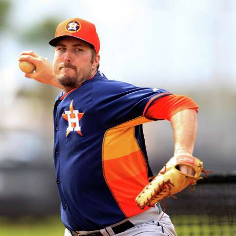 With 51 career saves, Chad Qualls has the most experience among the Astros' closing options. Photo: Karen Warren, Staff / © 2013 Houston Chronicle