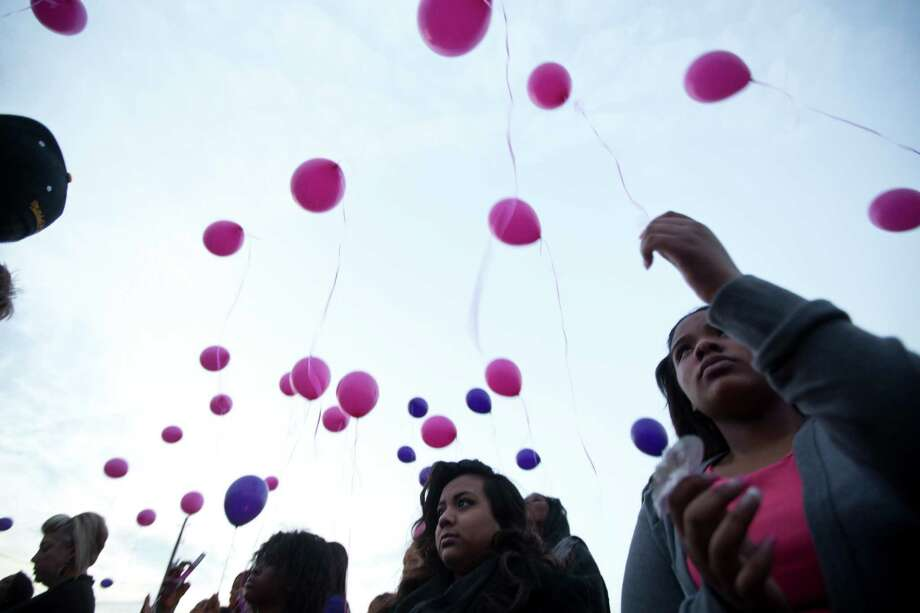 Hailey Reed, 17, releases a pink balloon during the prayer vigil for Hill. Reed and Hill were friends from school. Tuesday, March 25, 2014. Photo: Marie D. De Jesus, Houston Chronicle / © 2014 Houston Chronicle