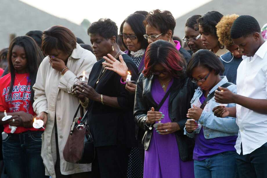 Friends and family mourn the death of Arrijana Hillin Arrijana Hill who was murdered  in her home during a prayer vigil at Crossroads Community Church in Pearland, Tuesday, March 25, 2014. Photo: Marie D. De Jesus, Houston Chronicle / © 2014 Houston Chronicle