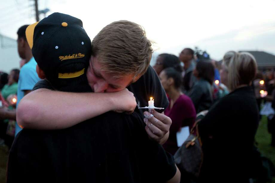 Roger Vyrostek, 17, grieves with his friend Joshua Gamboa, 18. Tuesday, March 25, 2014. Photo: Marie D. De Jesus, Houston Chronicle / © 2014 Houston Chronicle