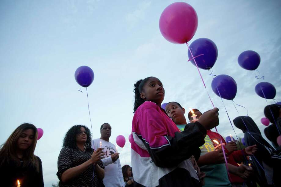 Kamryn Williams, 12, holds a balloon that was later released to honor Hill. Tuesday, March 25, 2014. Photo: Marie D. De Jesus, Houston Chronicle / © 2014 Houston Chronicle