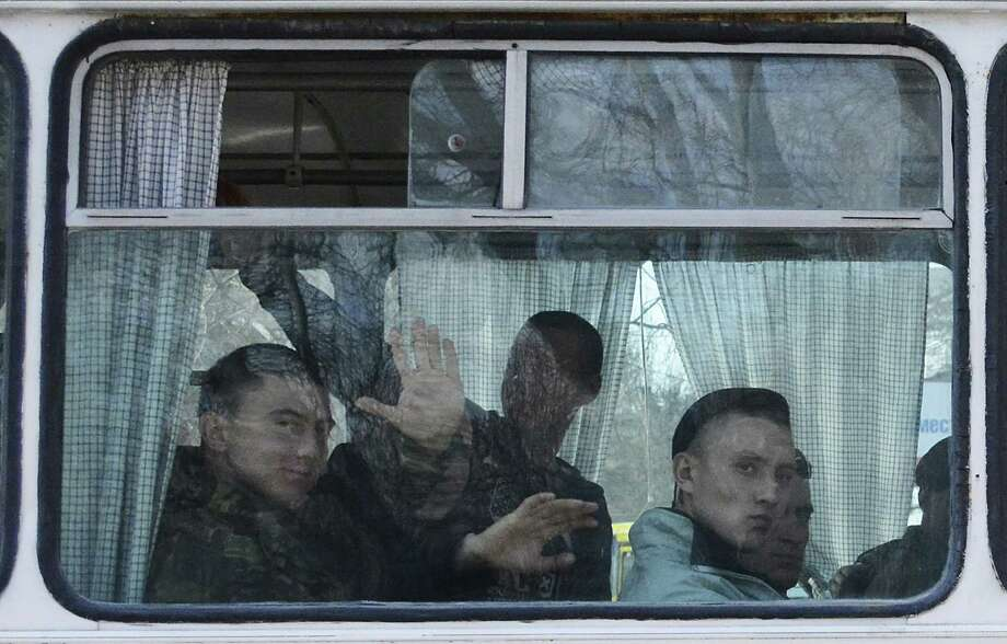 Ukrainian marines who didn't want to switch their allegiance to serve under Russia's military leave their overrun base in Crimea. Photo: Valeriy Kulyk / Associated Press / AP