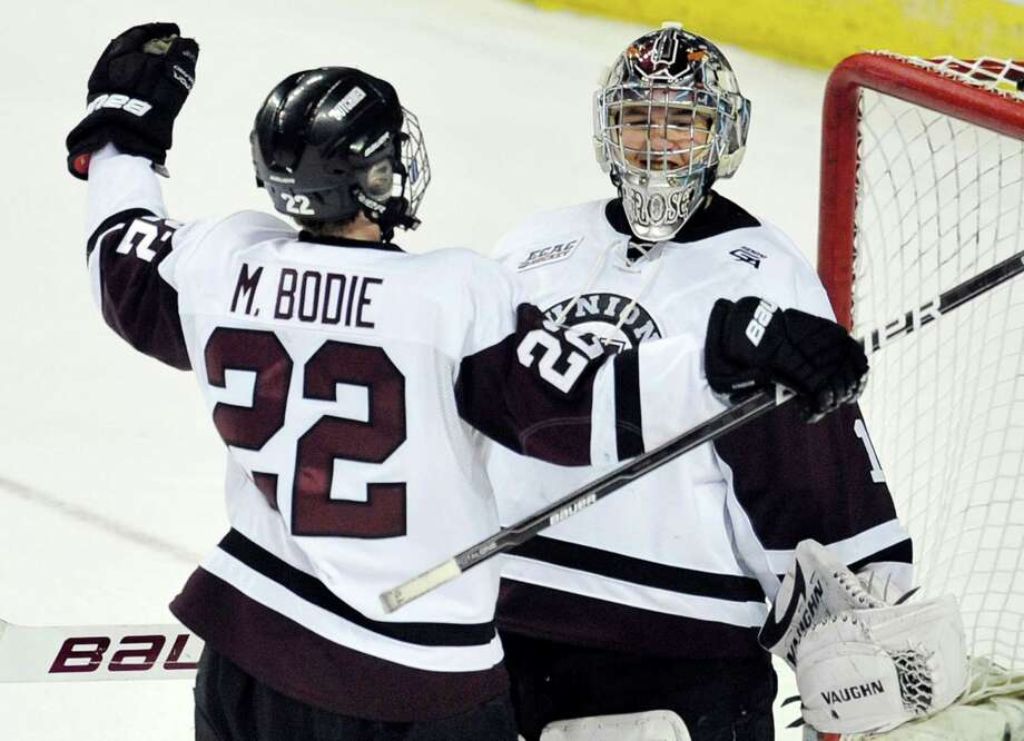 Union College's Mat Bodie, left, and goalie Troy Grosenick celebrate their 4-2 win over Massachusetts Lowell in an East Regional final game in the NCAA college hockey tournament in Bridgeport, Conn., Saturday, March 24, 2012. (AP Photo/Jessica Hill) Photo: Jessica Hill / AP2012