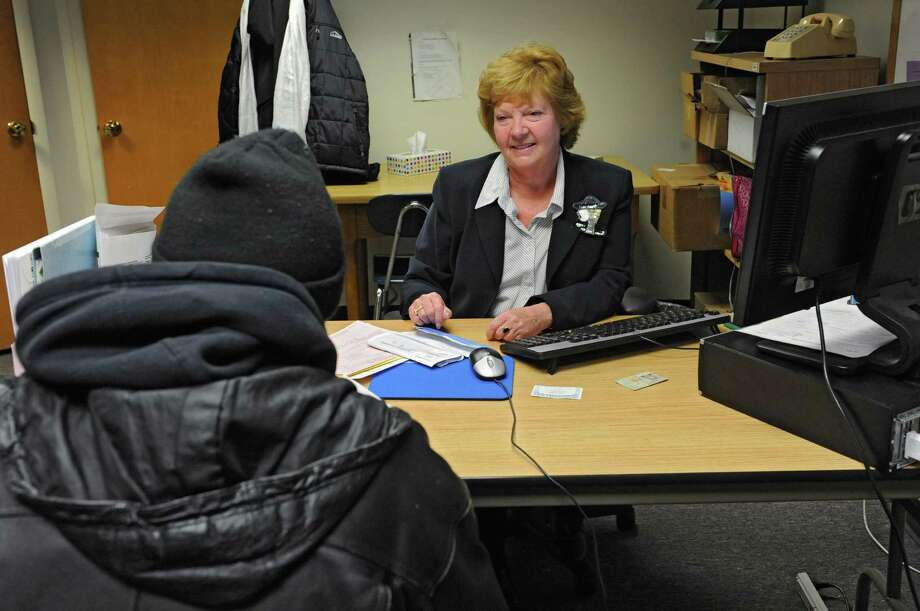 Tax preparer Lynne Kramer helps a man file his taxes in the Volunteer Income Tax Assistance (VITA) office at the New York State Office of Temporary and Disability Assistance on North Pearl St. Tuesday, March 25, 2014 in Albany, N.Y.  (Lori Van Buren / Times Union) Photo: Lori Van Buren / 00026253A