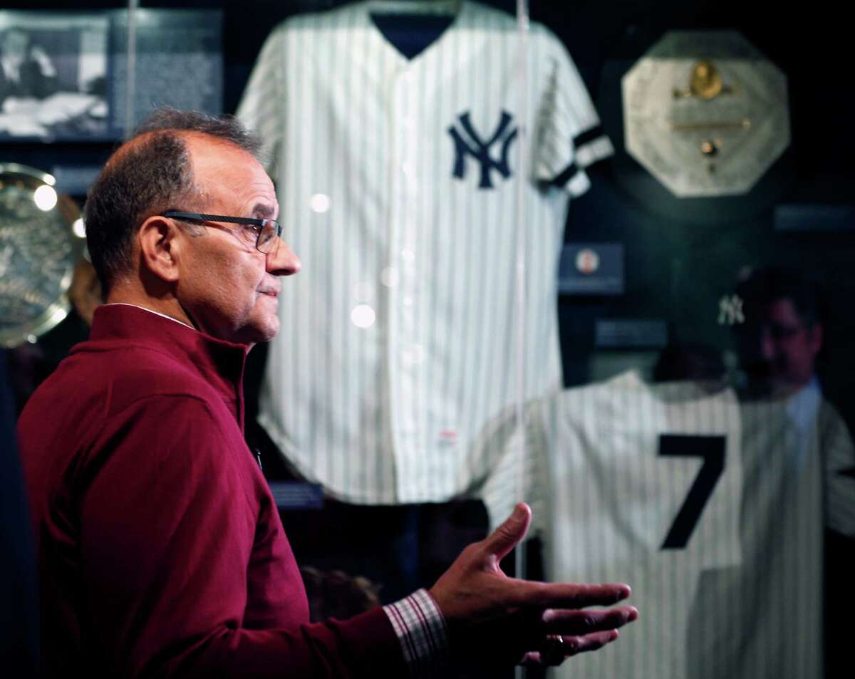 Former New York Yankees manager Joe Torre looks at a Yankees exhibit during his orientation visit at the Baseball Hall of Fame on Tuesday, March 25, 2014, in Cooperstown, N.Y. Torre will be inducted to the hall in July. (AP Photo/Mike Groll) ORG XMIT: NYMG101