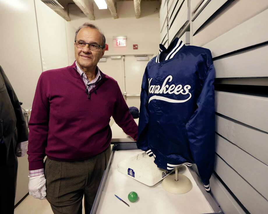 Former New York Yankees manager Joe Torre poses with his jacket from the 1999 World Series during his orientation visit at the Baseball Hall of Fame on Tuesday, March 25, 2014, in Cooperstown, N.Y. Torre will be inducted to the hall in July. (AP Photo/Mike Groll) ORG XMIT: NYMG111 Photo: Mike Groll / AP