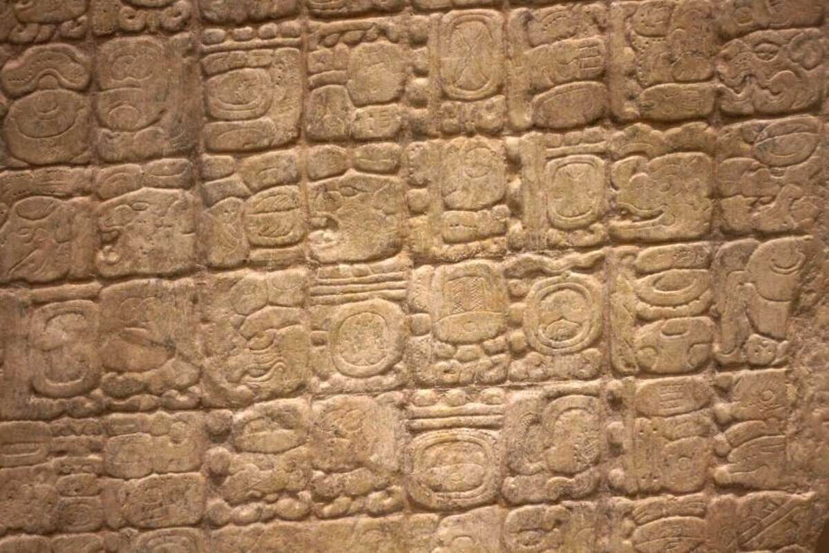 Here's a detail of the troublemaker. The photo shows a replica of the Sixth Monument, which mentions the 13th Baktun, the end of a major 5,125-year cycle in the Mayan Long Count calendar. And for many the end of the Mayan calendar meant the end of the world. (AP Photo/Israel Leal)