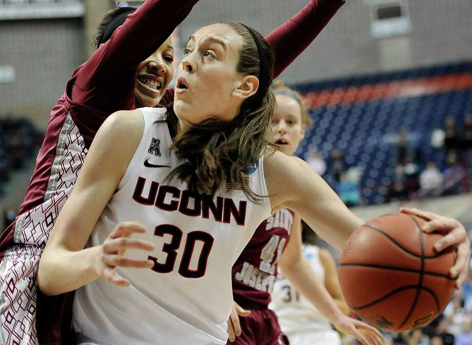 Connecticut's Breanna Stewart, right, pushes past Saint Joseph's Ashley Robinson, left, during the second half of a second-round game of the NCAA women's college basketball tournament, Tuesday, March 25, 2014, in Storrs, Conn. (AP Photo/Jessica Hill) ORG XMIT: CTJH113 Photo: Jessica Hill / FR125654 AP