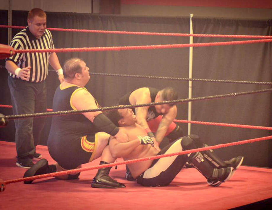 Wrestlers take part in a match during a recent Block Buster Wrestling show in New Braunfels. Photo: Courtesy Photo