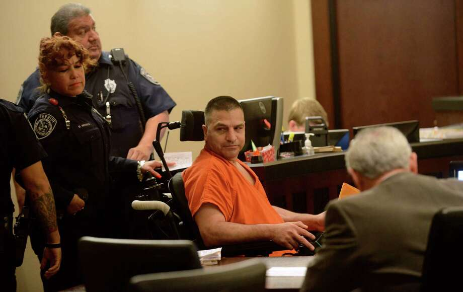 Roland Aguiar's proposed plea deal would have capped his sentence for murder to 15 years. He was accused of speeding and crashing a pickup after an attempted theft, resulting in the death of one of his passengers. His case goes back on the court's trial docket. Photo: Billy Calzada / San Antonio Express-News / San Antonio Express-News