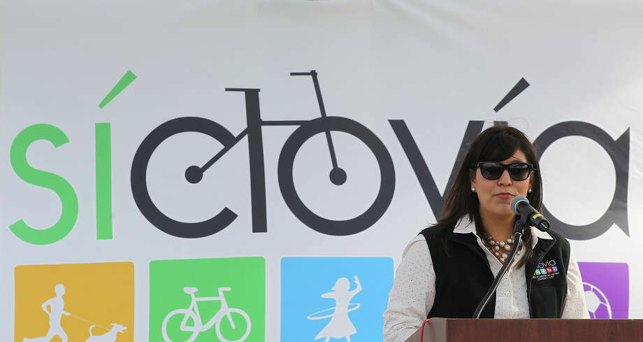 YMCA of Greater San Antonio Director of Community Wellness Monica Garza speaks during a press conference at Roosevelt Park on Tuesday, March 25, 2014. The schedule for this Sunday's Siclovia was announced with the route changing from Broadway Street to a route on the south side of downtown. Siclovia will start at the intersection of East Cesar Chavez Boulevard and South St. Mary's Street south to Mission Concepcion. The 2.5-mile course will be close to vehicular traffic from 11 a.m. to 4 p.m. and is expected to draw over 65,000 people. Photo: San Antonio Express-News / © 2014 San Antonio Express-News