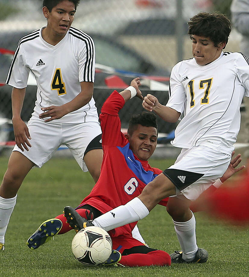 Jefferson's Ever Escalante (center) makes a tackle on Acevedo as the Mustangs dominated at the Northside ISD Complex. Photo: Photos By Tom Reel / San Antonio Express-News