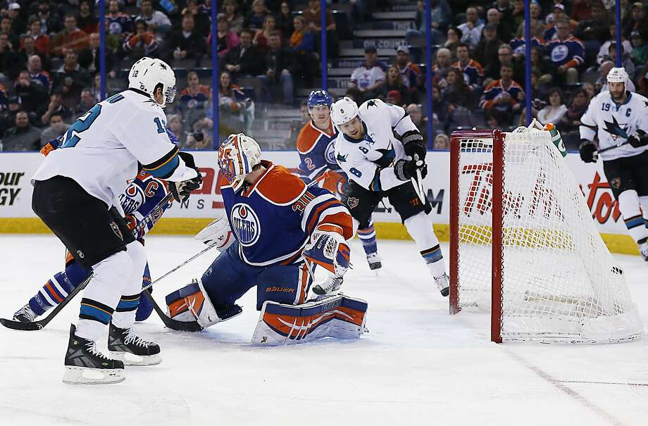 Sharks forward Joe Pavelski (8) scores on Oilers goaltender Ben Scrivens during the second period. Pavelski added two  goals in the third. Photo: Perry Nelson, Reuters