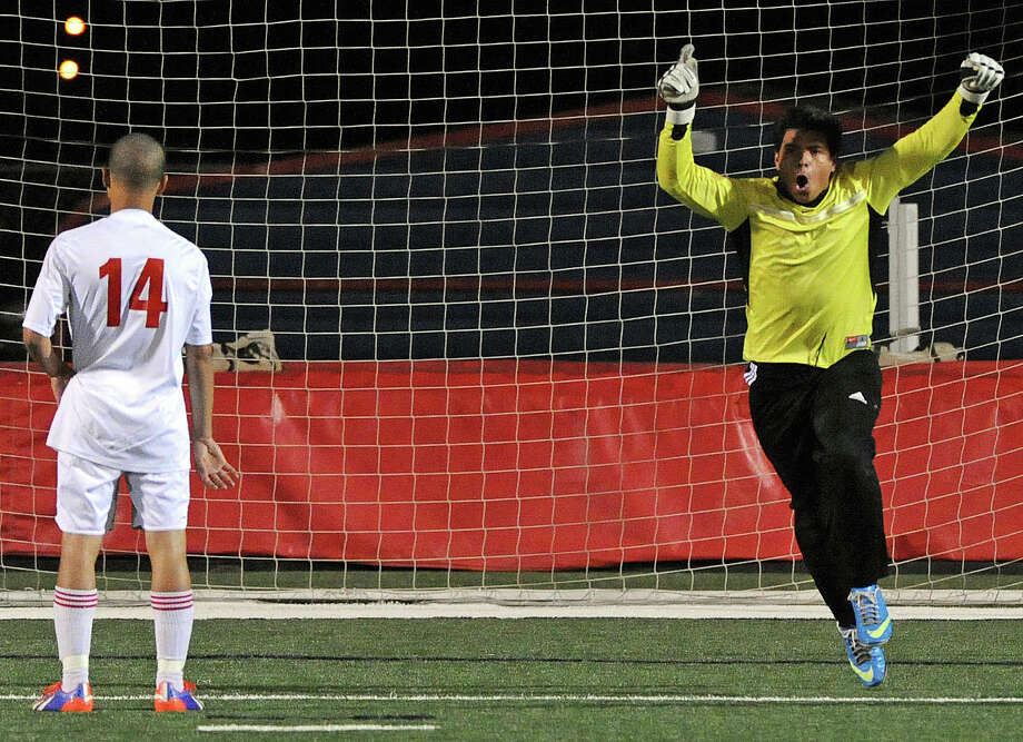 Sharpstown goalkeeper Edgar Rodriguez, right, is delighted after Dawson's Rami Banton (14) missed a penalty kick to seal the Apollos' shootout victory. Photo: Eric Christian Smith, Freelance