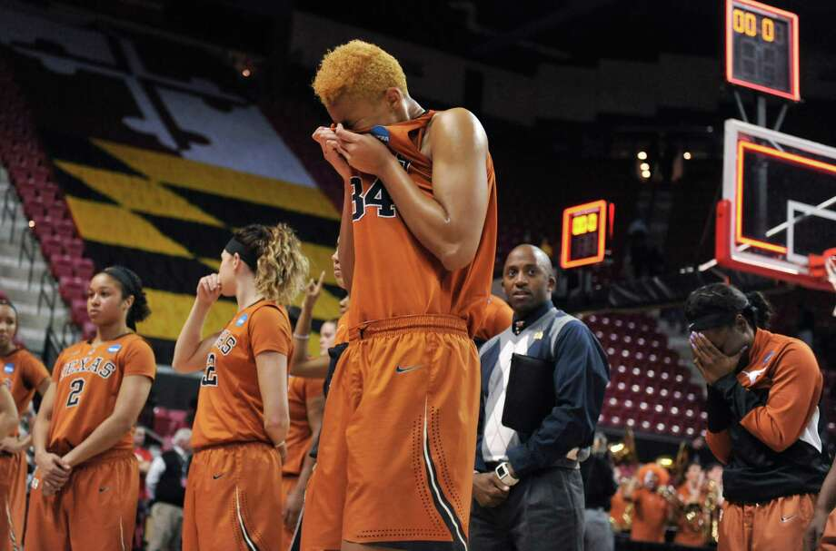 Center Imani McGee-Stafford tries to deal with Texas' loss. Photo: GAIL BURTON, FRE / FR4095 AP