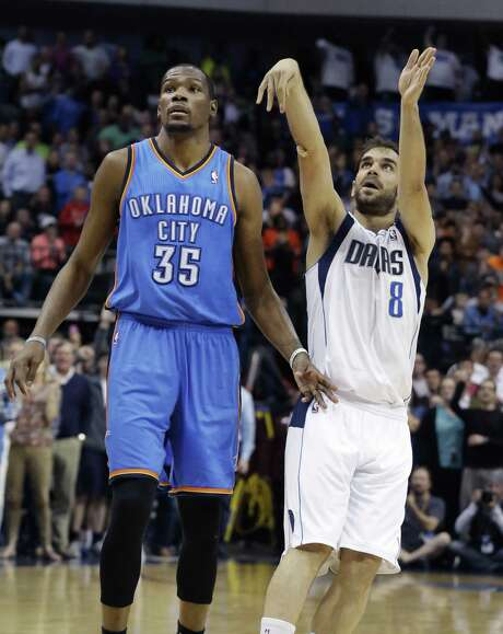 Mavs guard Jose Calderon (right) watches his three go in as a helpless Kevin Durant of OKC looks on. Photo: LM Otero / Associated Press / AP