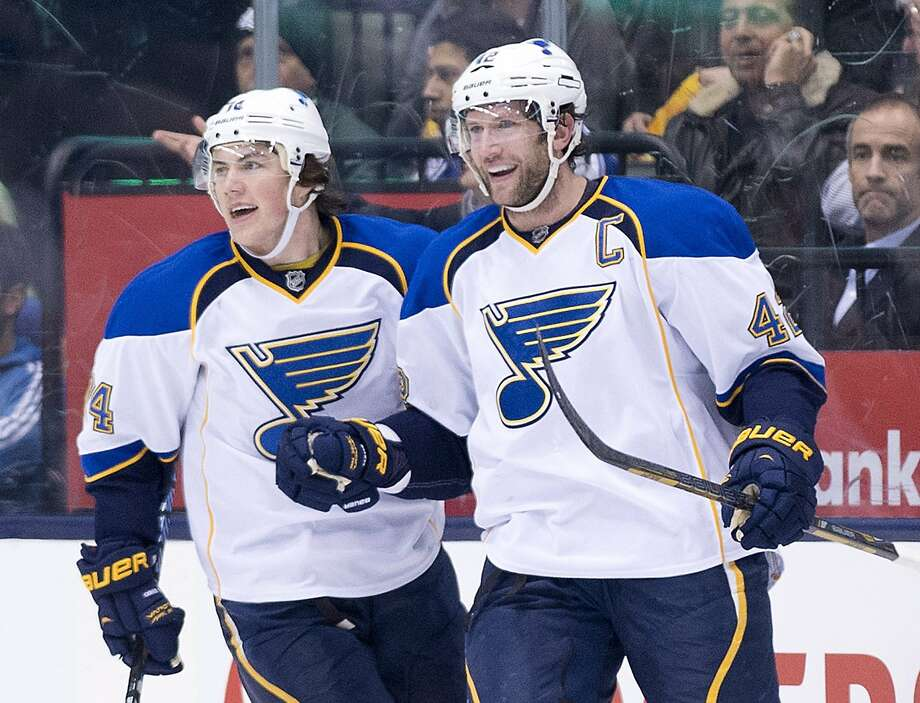 Blues forward David Backes (right) celebrates his second-period goal with teammate T.J. Oshie. Photo: Nathan Denette, Associated Press
